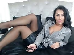 Fantastic Brilliant Black Haired Stunner Was Posing Fully Clothed On Her Sofa